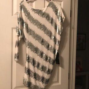 STUNNING NEVER WORN Bebe Addiction Sequin dress